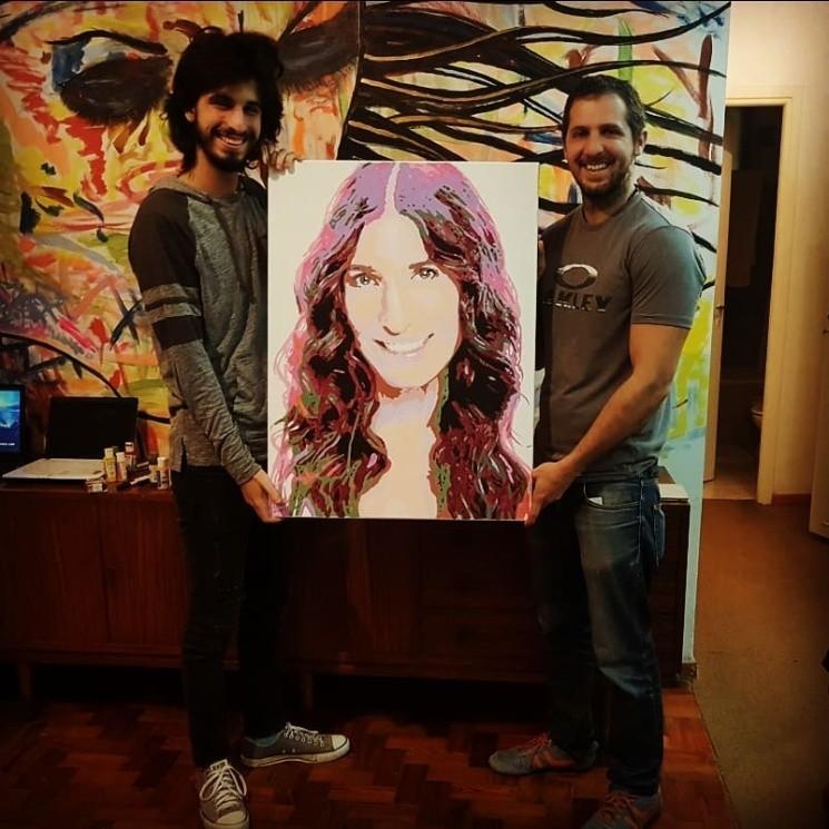 Franco Yan junto al autor del cuadro, Lukas Nicolini.